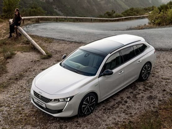 Peugeot 508 SW at the side of a mountain road