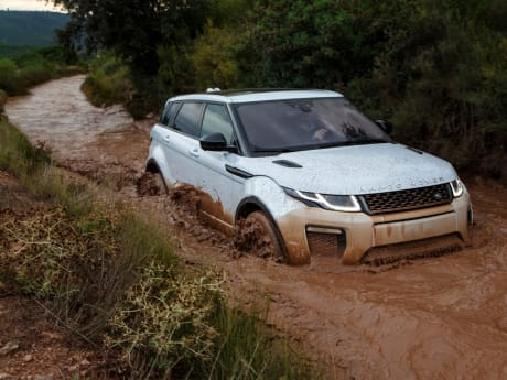 Range Rover Driving Through Deep Water