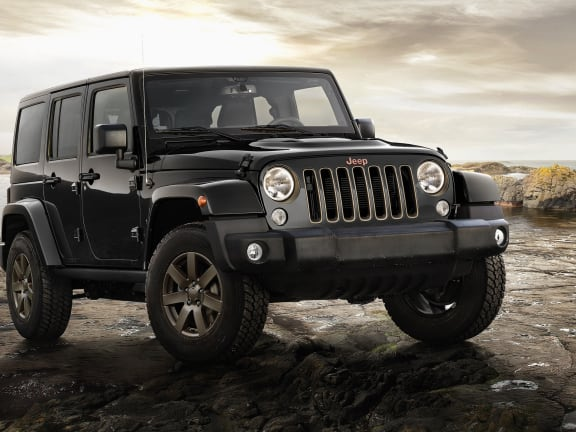 Front view of a Black Jeep Wrangler on a rock