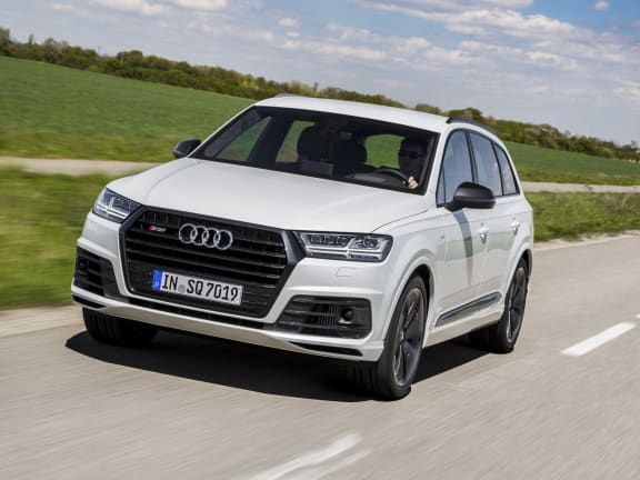 Front view of a white Audi SQ7 driving on a road