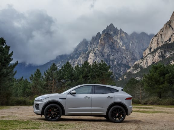 Side View of Jaguar E-Pace parked in front of a mountain