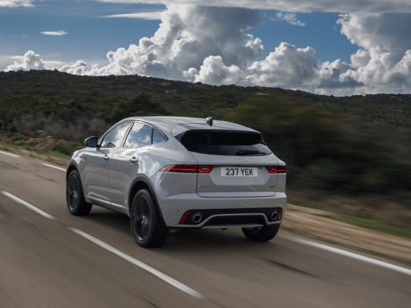 Rear View of Jaguar E-Pace driving on a road